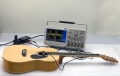 H4-34: GUITAR AND OSCILLOSCOPE